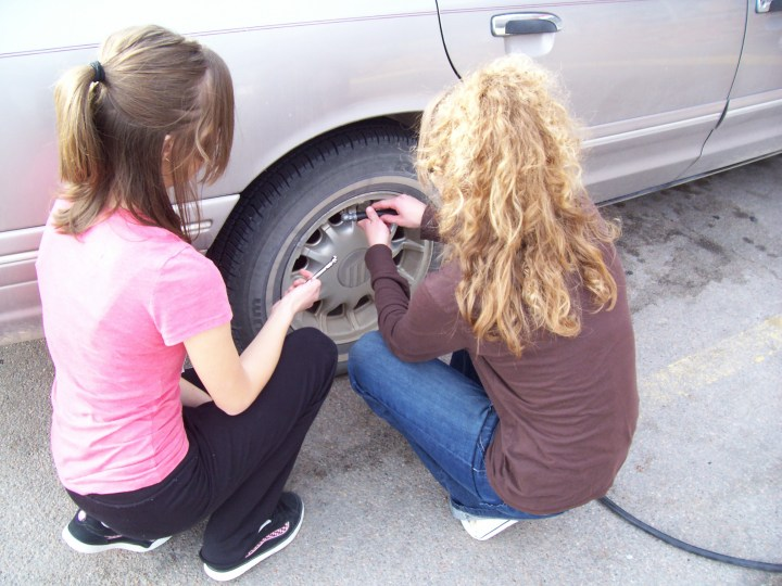 Sarah and Jenny learning to fill tires.